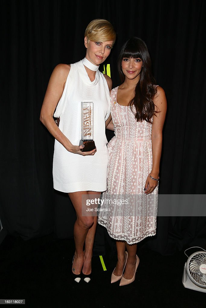 Honoree Charlize Theron (L) and actress Hannah Simone attend Variety's 5th Annual Power of Women event presented by Lifetime at the Beverly Wilshire Four Seasons Hotel on October 4, 2013 in Beverly Hills, California.