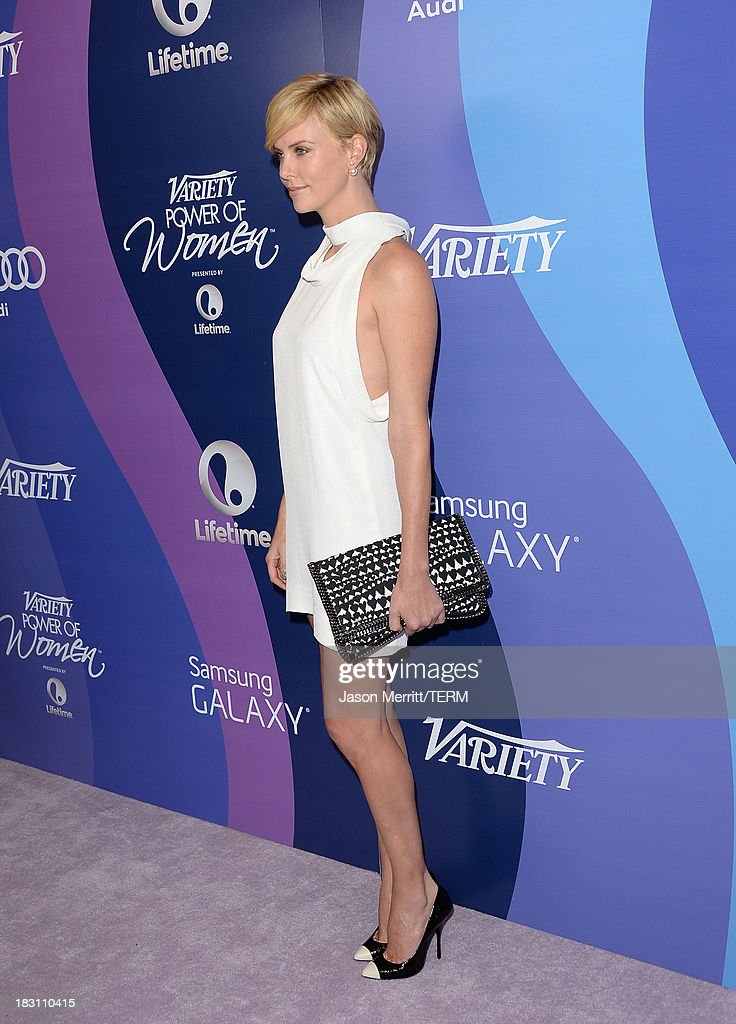 Honoree Charlize Theron arrives at Variety's 5th Annual Power of Women event presented by Lifetime at the Beverly Wilshire Four Seasons Hotel on October 4, 2013 in Beverly Hills, California.
