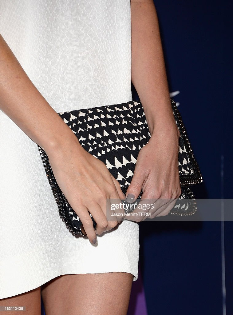 Honoree Charlize Theron (clutch detail) arrives at Variety's 5th Annual Power of Women event presented by Lifetime at the Beverly Wilshire Four Seasons Hotel on October 4, 2013 in Beverly Hills, California.