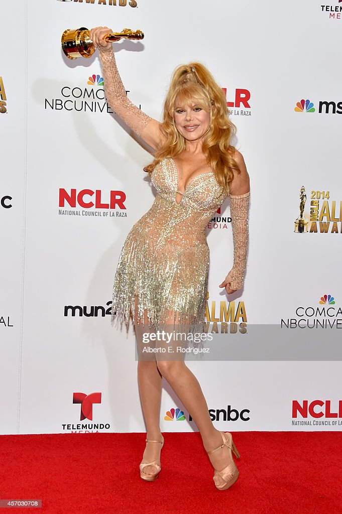 Honoree Charo poses with the Ricardo Montalban Award for Lifetime Achievement at the Winner's Walk during the 2014 NCLR ALMA Awards at the Pasadena...