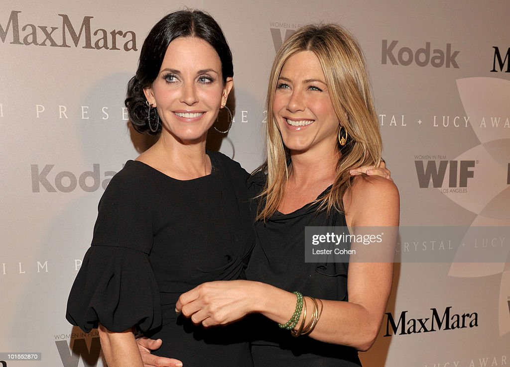 Honoree Courteney Cox Arquette and actress Jennifer Aniston arrive at the 2010 Crystal + Lucy Awards: A New Era at Hyatt Regency Century Plaza on June 1, 2010 in Century City, California.