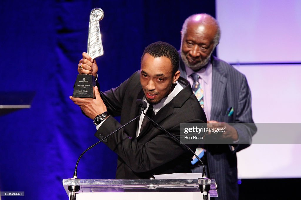 Honoree Dallas Austin speaks while music executive Clarence Avant looks on during The Andrew Young Foundation's celebration of the 80th birthday of Andrew Young at The Hyatt Regency Atlanta on May 20, 2012 in Atlanta, Georgia.