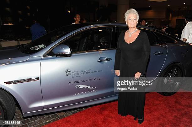 Honoree Dame Judi Dench arrives at the 2014 BAFTA LA Jaguar Britannia Awards with Jaguar North America in a Jaguar XJ at The Beverly Hilton Hotel on...