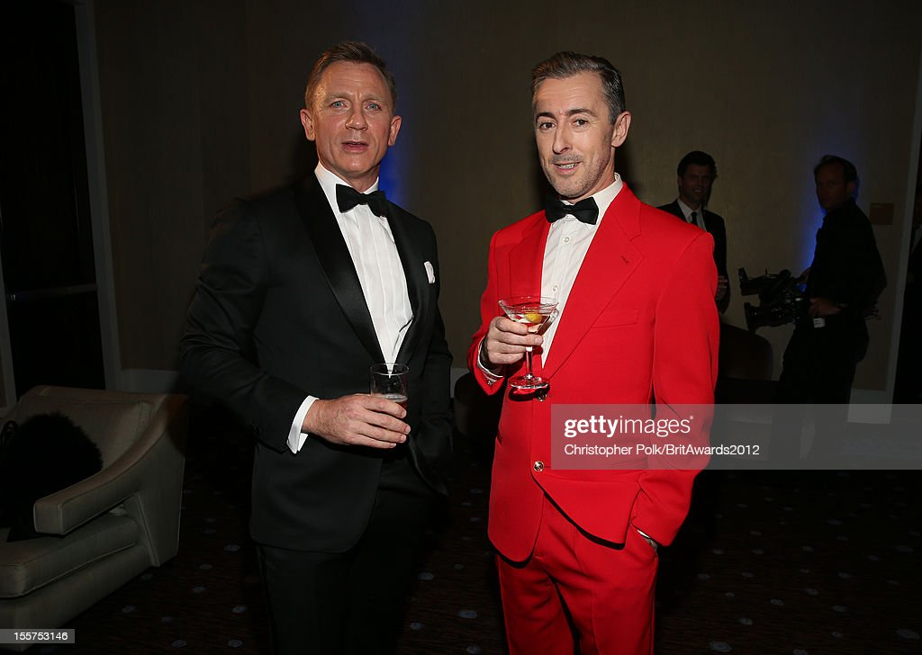 Honoree Daniel Craig and host <a gi-track='captionPersonalityLinkClicked' href=/galleries/search?phrase=Alan+Cumming&family=editorial&specificpeople=202521 ng-click='$event.stopPropagation()'>Alan Cumming</a> pose in the Honoree Green Room during the 2012 BAFTA Los Angeles Britannia Awards Presented By BBC AMERICA at The Beverly Hilton Hotel on November 7, 2012 in Beverly Hills, California.