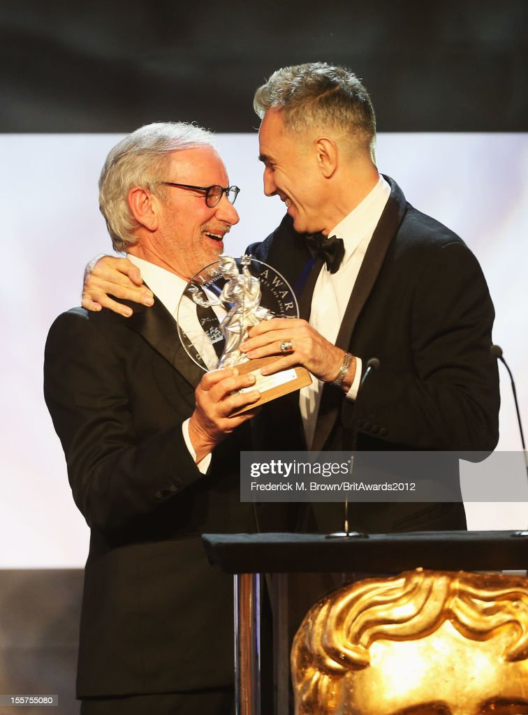 Honoree <a gi-track='captionPersonalityLinkClicked' href=/galleries/search?phrase=Daniel+Day-Lewis&family=editorial&specificpeople=211475 ng-click='$event.stopPropagation()'>Daniel Day-Lewis</a> accepts The Stanley Kubrick Britannia Award for Excellence in Film from presenter <a gi-track='captionPersonalityLinkClicked' href=/galleries/search?phrase=Steven+Spielberg&family=editorial&specificpeople=202022 ng-click='$event.stopPropagation()'>Steven Spielberg</a> onstage at the 2012 BAFTA Los Angeles Britannia Awards Presented By BBC AMERICA at The Beverly Hilton Hotel on November 7, 2012 in Beverly Hills, California.