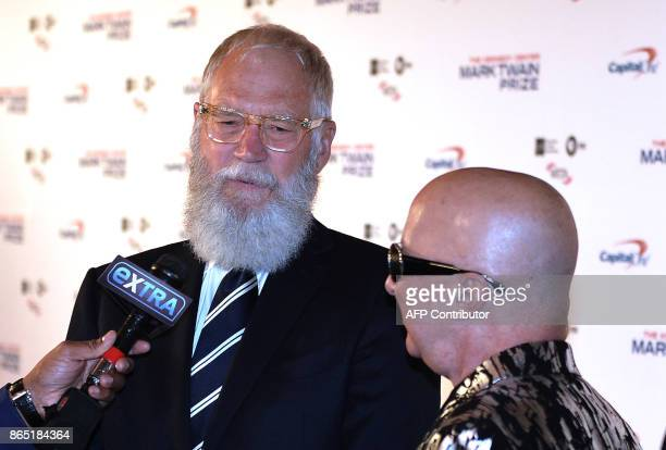Honoree David Letterman does an interview next to musician Paul Shaffer at the 20th Annual Mark Twain Prize for American Humor at the Kennedy Center...