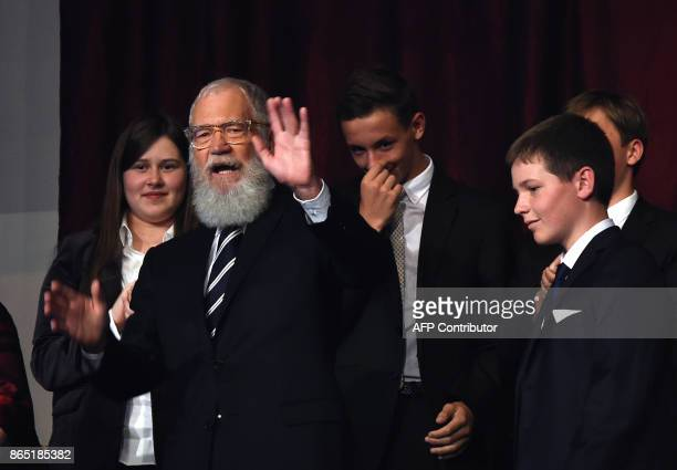 Honoree David Letterman waves during the show at the 20th Annual Mark Twain Prize for American Humor at the Kennedy Center in Washington DC on...