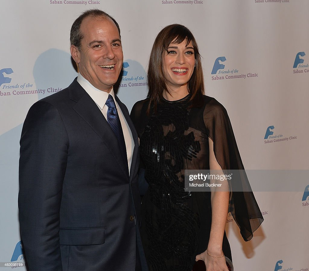 Honoree David Nevins, President of Entertainment of Showtime Networks Inc., (L) and actress <a gi-track='captionPersonalityLinkClicked' href=/galleries/search?phrase=Lizzy+Caplan&family=editorial&specificpeople=599560 ng-click='$event.stopPropagation()'>Lizzy Caplan</a> arrive at the 37th Annual Saban Community Clinic Gala at The Beverly Hilton Hotel on November 25, 2013 in Beverly Hills, California.
