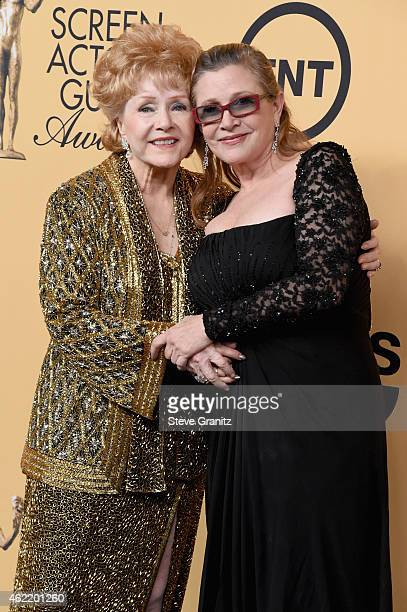 Honoree Debbie Reynolds and actress Carrie Fisher pose in the press room at the 21st Annual Screen Actors Guild Awards at The Shrine Auditorium on...