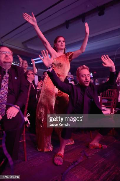 Honoree Debra Messing and actor Max Jenkins dance at the 28th Annual GLAAD Media Awards at The Hilton Midtown on May 6 2017 in New York City