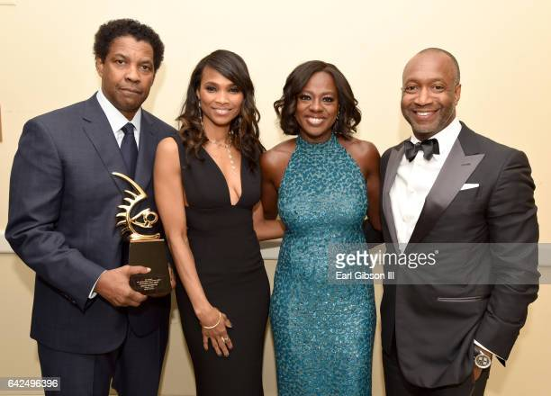 Honoree Denzel Washington Nicole Friday actor Viola Davis and founder of the ABFF Jeff Friday pose with the Hollywood Legacy Award during BET...