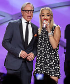 Honoree designer Tommy Hilfiger and recording artist Rita Ora perform onstage during the 22nd Annual Race To Erase MS Event at the Hyatt Regency...