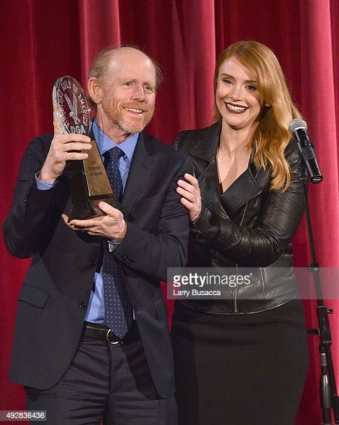 Honoree Director Ron Howard accepts award from presenter Bryce Dallas Howard onstage at the DGA Honors 2015 Gala on October 15 2015 in New York City
