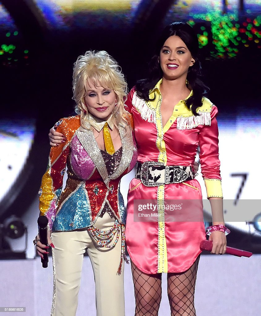 Honoree Dolly Parton (L) and recording artist Katy Perry perform onstage during the 51st Academy of Country Music Awards at MGM Grand Garden Arena on April 3, 2016 in Las Vegas, Nevada.