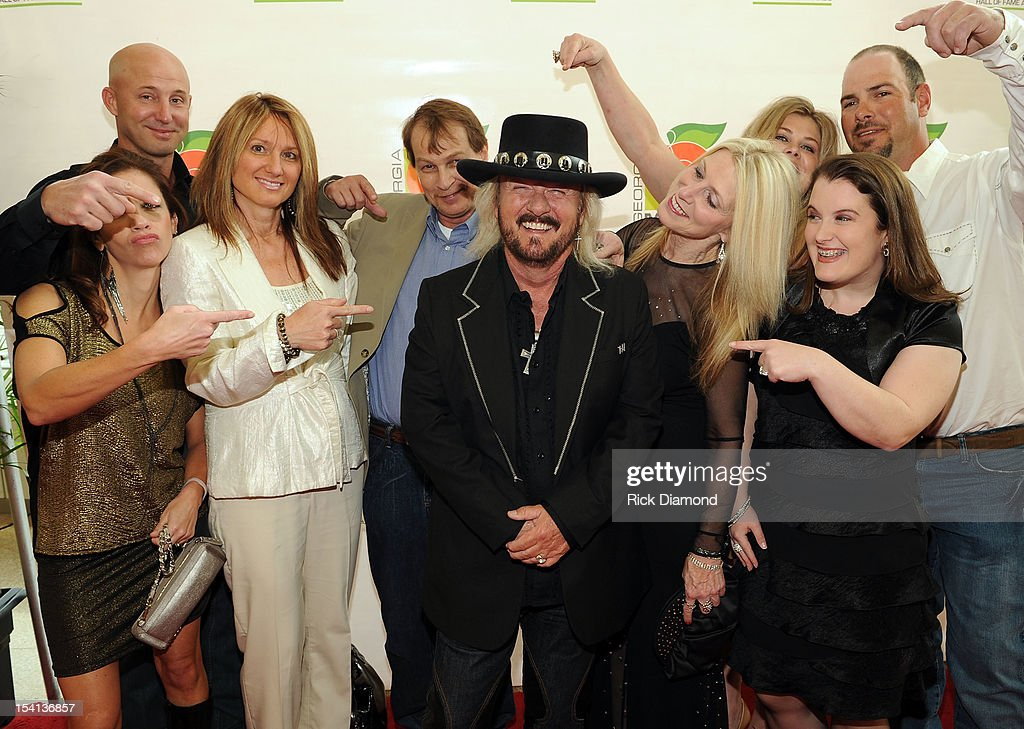 Honoree <a gi-track='captionPersonalityLinkClicked' href=/galleries/search?phrase=Donnie+Van+Zant&family=editorial&specificpeople=226742 ng-click='$event.stopPropagation()'>Donnie Van Zant</a> of 38 special (center) and family walk the Red Carpet before the 34th Annual Georgia Music Hall of Fame Awards Concert and Show at Cobb Energy Performing Arts Center on October 14, 2012 in Atlanta, Georgia.