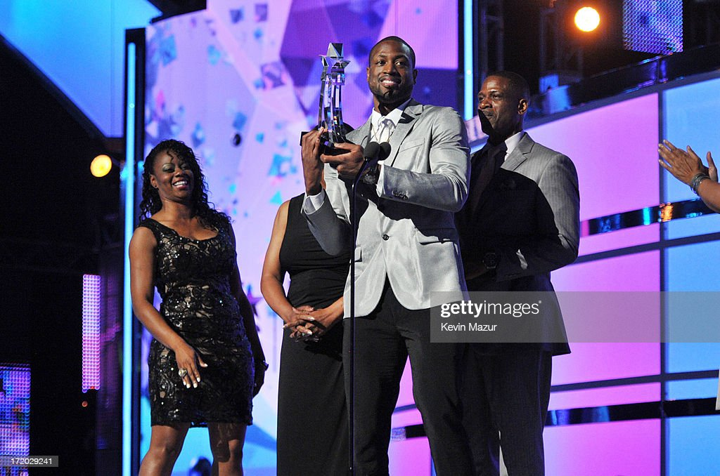 Honoree <a gi-track='captionPersonalityLinkClicked' href=/galleries/search?phrase=Dwyane+Wade&family=editorial&specificpeople=201481 ng-click='$event.stopPropagation()'>Dwyane Wade</a> accepts award onstage during the 2013 BET Awards at Nokia Theatre L.A. Live on June 30, 2013 in Los Angeles, California.