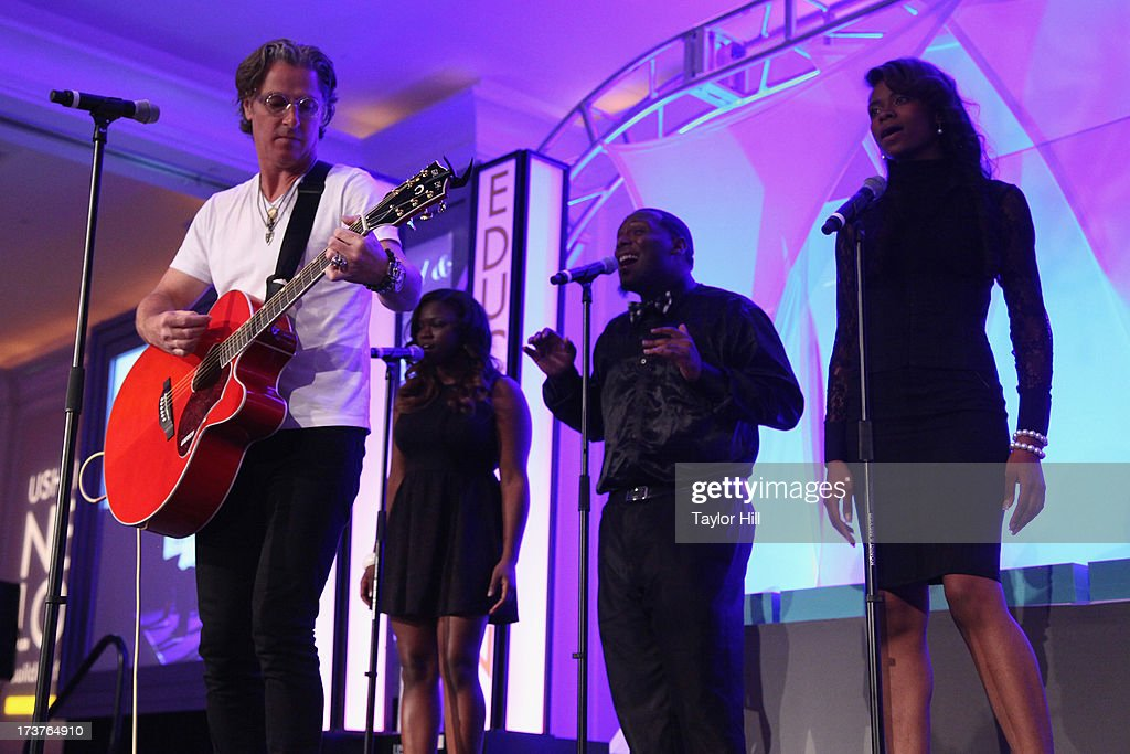 Honoree <a gi-track='captionPersonalityLinkClicked' href=/galleries/search?phrase=Ed+Roland+-+Musician&family=editorial&specificpeople=2123432 ng-click='$event.stopPropagation()'>Ed Roland</a> of Collective Soul performs with the Usher's New Look Foundation Choir at Usher's New Look's 2013 President's Circle Awards Luncheon at St. Regis Atlanta on July 17, 2013 in Atlanta, Georgia.