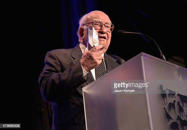 Honoree Edward Asner accepts the Lifetime Achievement Award onstage during The Humane Society Of The United States' Los Angeles Benefit Gala at the...