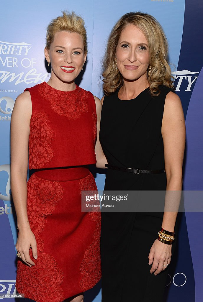 Honoree <a gi-track='captionPersonalityLinkClicked' href=/galleries/search?phrase=Elizabeth+Banks&family=editorial&specificpeople=202475 ng-click='$event.stopPropagation()'>Elizabeth Banks</a> and Publisher of Variety <a gi-track='captionPersonalityLinkClicked' href=/galleries/search?phrase=Michelle+Sobrino&family=editorial&specificpeople=3065766 ng-click='$event.stopPropagation()'>Michelle Sobrino</a> attend Variety's 5th Annual Power of Women event presented by Lifetime at the Beverly Wilshire Four Seasons Hotel on October 4, 2013 in Beverly Hills, California.