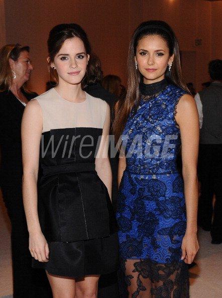 Honoree Emma Watson and actress Nina Dobrev attend ELLEs ...