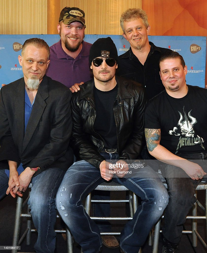 Honoree <a gi-track='captionPersonalityLinkClicked' href=/galleries/search?phrase=Eric+Church&family=editorial&specificpeople=619568 ng-click='$event.stopPropagation()'>Eric Church</a> (center) and his band at BMI's #1 Party For <a gi-track='captionPersonalityLinkClicked' href=/galleries/search?phrase=Eric+Church&family=editorial&specificpeople=619568 ng-click='$event.stopPropagation()'>Eric Church</a>'s 'Drink In My Hand' at BMI on February 28, 2012 in Nashville, Tennessee.
