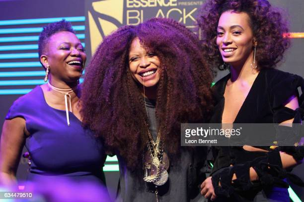 Honoree Erykah Badu accepts award from Essence editorinchief Vanessa DeLuca and recording artist Solange Knowles onstage during 2017 Essence Black...
