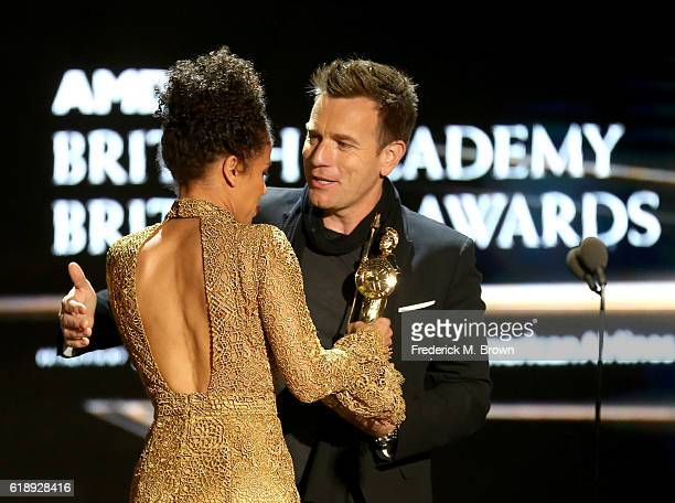 Honoree Ewan McGregor accepts the Humanitarian Award from actress Gugu MbathaRaw onstage during the 2016 AMD British Academy Britannia Awards...