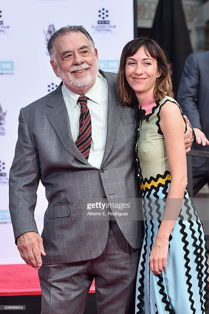 Honoree <a gi-track='captionPersonalityLinkClicked' href=/galleries/search?phrase=Francis+Ford+Coppola&family=editorial&specificpeople=204241 ng-click='$event.stopPropagation()'>Francis Ford Coppola</a> (L) and director <a gi-track='captionPersonalityLinkClicked' href=/galleries/search?phrase=Gia+Coppola&family=editorial&specificpeople=3099216 ng-click='$event.stopPropagation()'>Gia Coppola</a> attend the <a gi-track='captionPersonalityLinkClicked' href=/galleries/search?phrase=Francis+Ford+Coppola&family=editorial&specificpeople=204241 ng-click='$event.stopPropagation()'>Francis Ford Coppola</a> Hand and Footprint Ceremony during the TCM Classic Film Festival 2016 on April 29, 2016 in Los Angeles, California. 25826_006