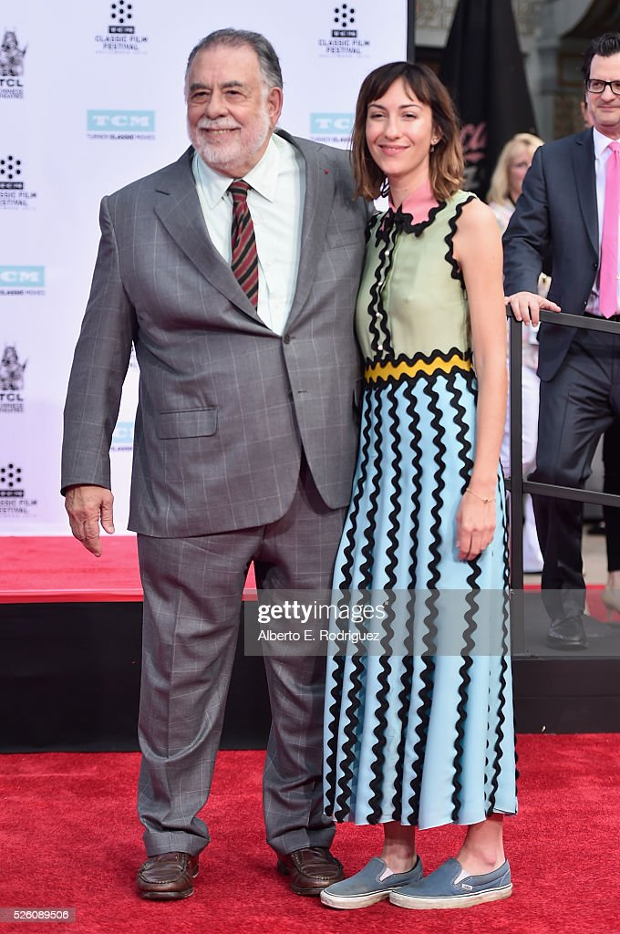 Honoree <a gi-track='captionPersonalityLinkClicked' href=/galleries/search?phrase=Francis+Ford+Coppola&family=editorial&specificpeople=204241 ng-click='$event.stopPropagation()'>Francis Ford Coppola</a> (L) and diretcor <a gi-track='captionPersonalityLinkClicked' href=/galleries/search?phrase=Gia+Coppola&family=editorial&specificpeople=3099216 ng-click='$event.stopPropagation()'>Gia Coppola</a> attend the <a gi-track='captionPersonalityLinkClicked' href=/galleries/search?phrase=Francis+Ford+Coppola&family=editorial&specificpeople=204241 ng-click='$event.stopPropagation()'>Francis Ford Coppola</a> Hand and Footprint Ceremony during the TCM Classic Film Festival 2016 on April 29, 2016 in Los Angeles, California. 25826_006