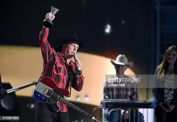 Honoree Garth Brooks accepts the 50th Anniversary Milestone Award onstage during the 50th Academy Of Country Music Awards at ATT Stadium on April 19...