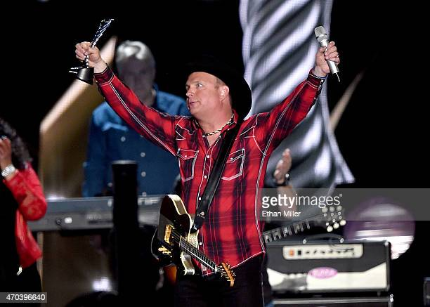 Honoree Garth Brooks accepts the Milestone Award onstage during the 50th Academy of Country Music Awards at ATT Stadium on April 19 2015 in Arlington...