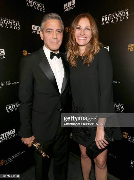Honoree George Clooney recipient of the Stanley Kubrick Britannia Award for Excellence in Film and actress Julia Roberts stand backstage during the...