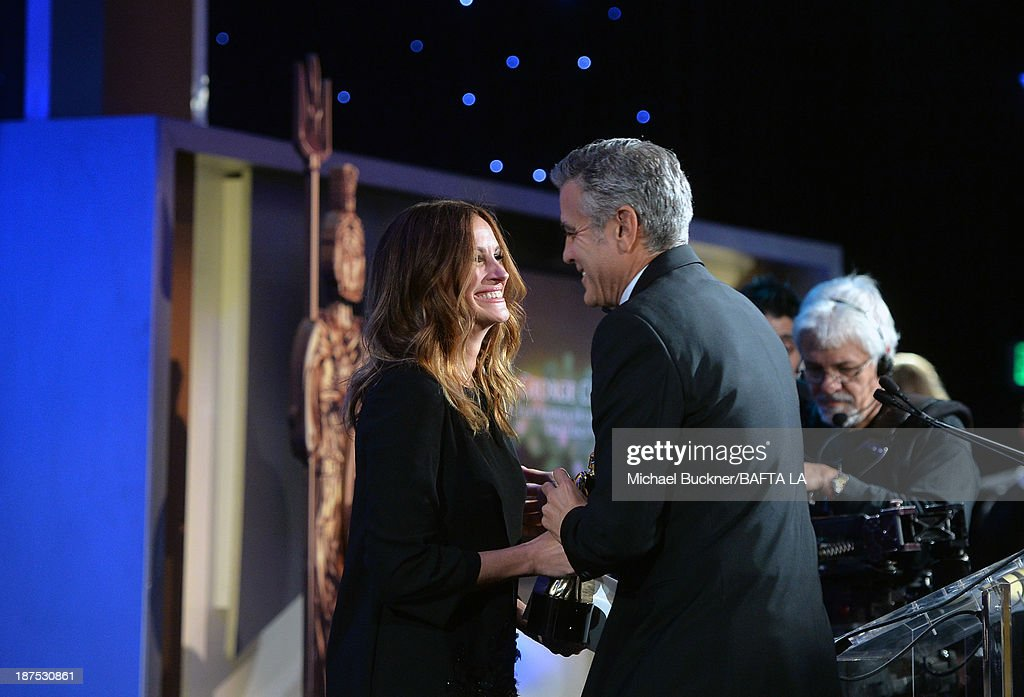 Honoree <a gi-track='captionPersonalityLinkClicked' href=/galleries/search?phrase=George+Clooney&family=editorial&specificpeople=202529 ng-click='$event.stopPropagation()'>George Clooney</a> (R), recipient of the Stanley Kubrick Britannia Award for Excellence in Film accepts his award from actress <a gi-track='captionPersonalityLinkClicked' href=/galleries/search?phrase=Julia+Roberts&family=editorial&specificpeople=202605 ng-click='$event.stopPropagation()'>Julia Roberts</a> onstage during the 2013 BAFTA LA Jaguar Britannia Awards presented by BBC America at The Beverly Hilton Hotel on November 9, 2013 in Beverly Hills, California.