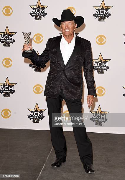 Honoree George Strait recipient of the Milestone Award for ACM Winner Over Four Decades poses in the press room at the 50th Academy of Country Music...