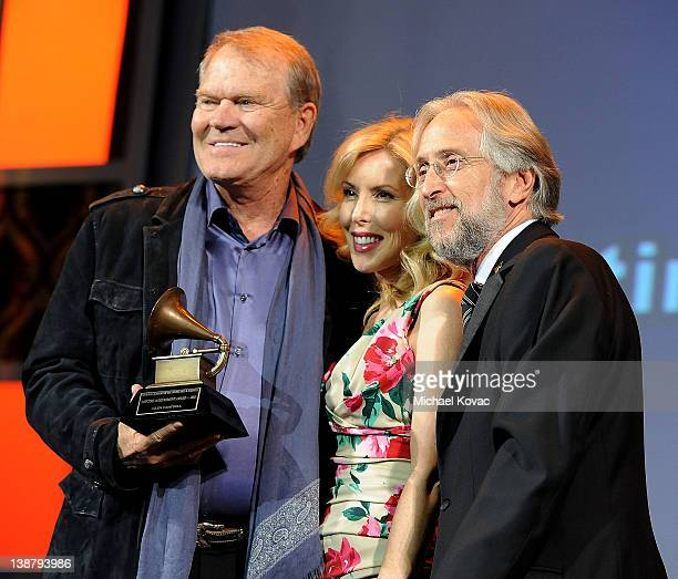 Honoree Glen Campbell with wife Kim Campbell accepts the Lifetime Achievement award from President/CEO of The Recording Academy Neil Portnow during...