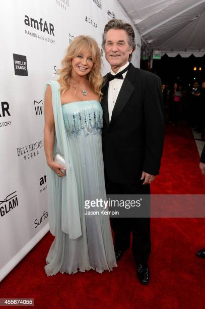 Honoree Goldie Hawn and actor Kurt Russell attend the 2013 amfAR Inspiration Gala Los Angeles at Milk Studios on December 12 2013 in Los Angeles...