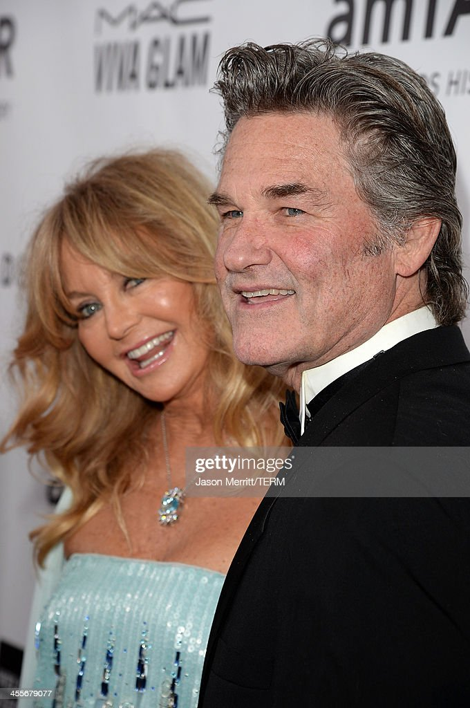 Honoree Goldie Hawn (L) and actor Kurt Russell attend the 2013 amfAR Inspiration Gala Los Angeles at Milk Studios on December 12, 2013 in Los Angeles, California.