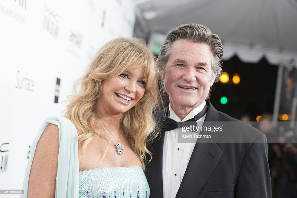 Honoree Goldie Hawn and Kurt Russell attend the 2013 amfAR Inspiration Gala Los Angeles at Milk Studios on December 12, 2013 in Los Angeles, California.