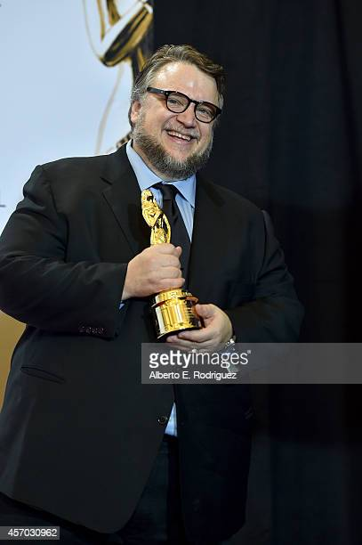 Honoree Guillermo del Toro poses with the Anthony Quinn Award for Industry Excellence at the Winner's Walk during the 2014 NCLR ALMA Awards at the...