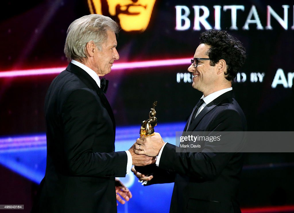 Honoree Harrison Ford (L) accepts the Albert R. Broccoli Britannia Award for Worldwide Contribution to Entertainment from director J.J. Abrams onstage during the 2015 Jaguar Land Rover British Academy Britannia Awards presented by American Airlines at The Beverly Hilton Hotel on October 30, 2015 in Beverly Hills, California.