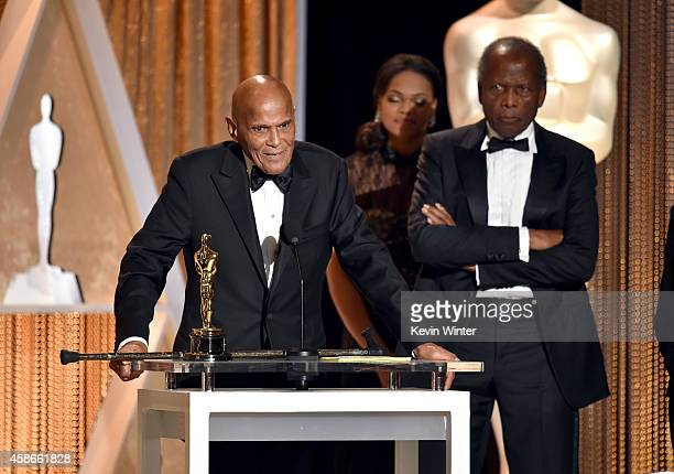 Honoree Harry Belafonte accepts the Jean Hersholt Humanitarian Award from actor Sidney Poitier onstage during the Academy Of Motion Picture Arts And...