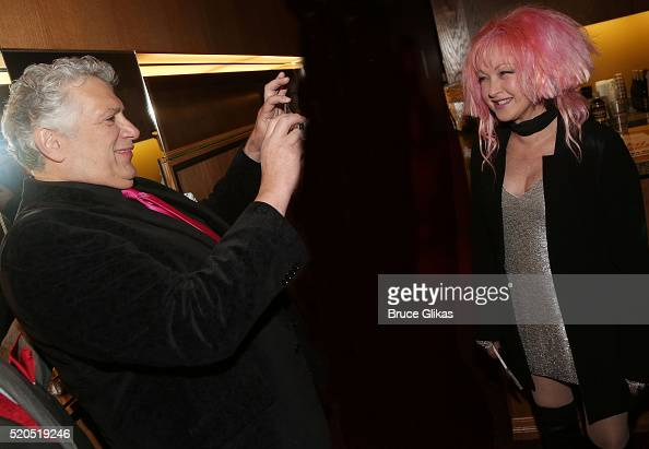 Honoree Harvey Fierstein snaps a photo of Cyndi Lauper as they are honored with a Double Star Ceremony on The Hollywood Walk Of Fame on April 11 2016...