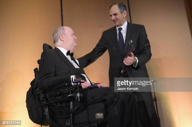 Honoree Henry G Stifel III and Reeve Foundation Vice Chairman John McConnell speak onstage during 'A Magical Evening' Gala hosted by The Christopher...