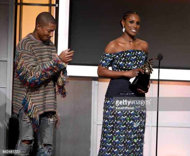 Honoree Issa Rae accepts the Rising Star Award from recording artist Pharrell Williams onstage during BET Presents the American Black Film Festival...