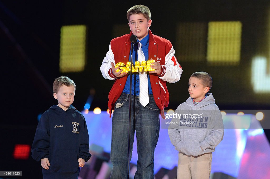 Honoree Jack Wellman (C), Steven Accamondo and Stephen Singlak accept the SI Kid Award onstage during Cartoon Network's fourth annual Hall of Game Awards at Barker Hangar on February 15, 2014 in Santa Monica, California.