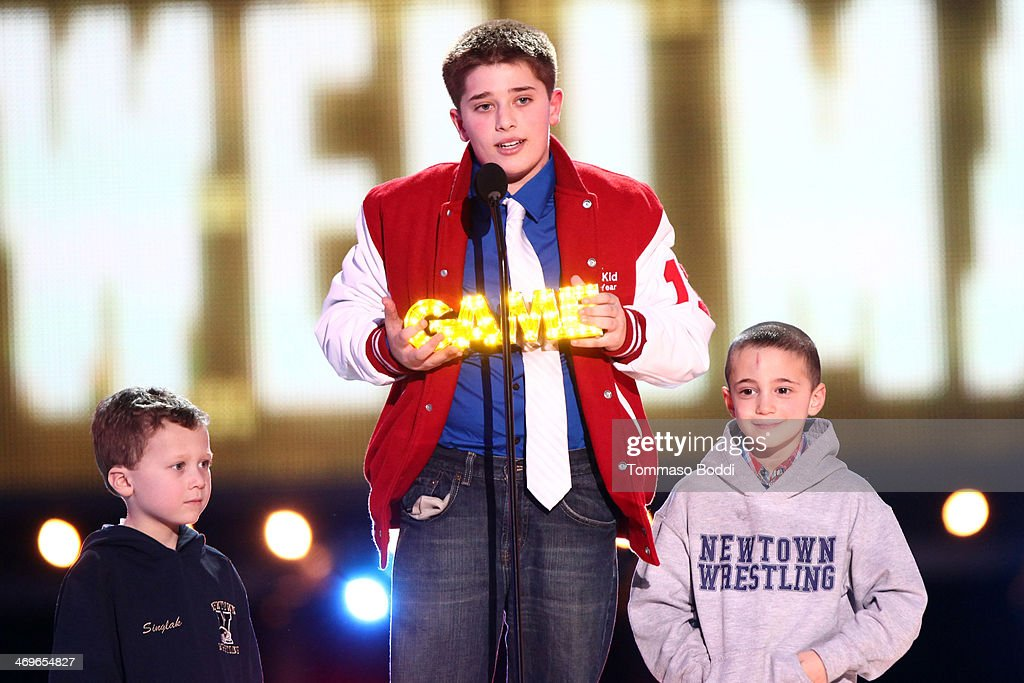 Honoree Jack Wellman (C), Steven Accamondo and Stephen Singlak accept the SI Kid Award onstage during the 4th Annual Cartoon Network Hall Of Game Awards held at the Barker Hangar on February 15, 2014 in Santa Monica, California.