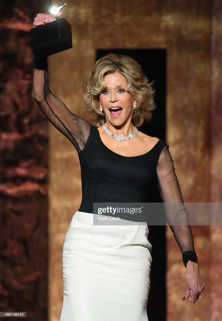 Honoree <a gi-track='captionPersonalityLinkClicked' href=/galleries/search?phrase=Jane+Fonda&family=editorial&specificpeople=202174 ng-click='$event.stopPropagation()'>Jane Fonda</a> accepts the AFI Life Achievement Award onstage at the 2014 AFI Life Achievement Award: A Tribute to <a gi-track='captionPersonalityLinkClicked' href=/galleries/search?phrase=Jane+Fonda&family=editorial&specificpeople=202174 ng-click='$event.stopPropagation()'>Jane Fonda</a> at the Dolby Theatre on June 5, 2014 in Hollywood, California. Tribute show airing Saturday, June 14, 2014 at 9pm ET/PT on TNT.