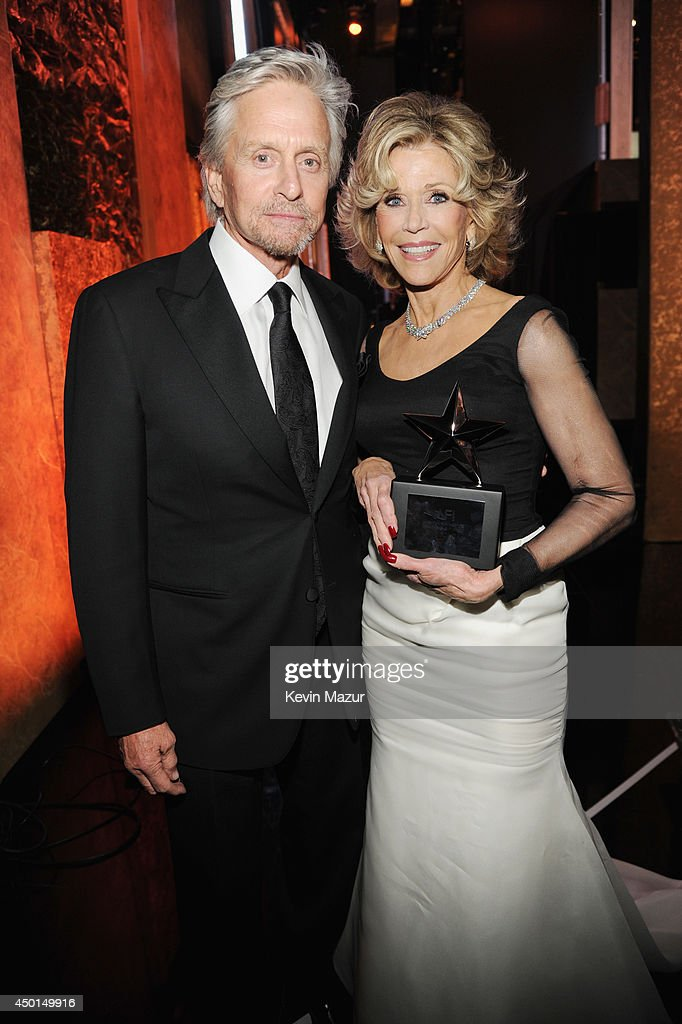 Honoree Jane Fonda (R) and actor Michael Douglas pose with the AFI Lifetime Achievement Award backstage during the 2014 AFI Life Achievement Award: A Tribute to Jane Fonda at the Dolby Theatre on June 5, 2014 in Hollywood, California. Tribute show airing Saturday, June 14, 2014 at 9pm ET/PT on TNT.