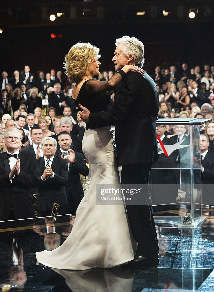 Honoree Jane Fonda (L) and actor Michael Douglas speak onstage during the 2014 AFI Life Achievement Award: A Tribute to Jane Fonda at the Dolby Theatre on June 5, 2014 in Hollywood, California. Tribute show airing Saturday, June 14, 2014 at 9pm ET/PT on TNT.