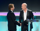 Honoree Jerry Bruckheimer accepts his American Cinematheque Award from actor Bruce Willis onstage during the 27th American Cinematheque Award...